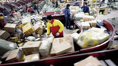 人民日报:快递业连接千城百业